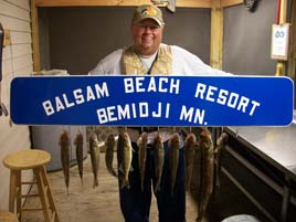Resort sign stringer of fish at Balsam Beach Resort.