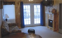 Cabin #3 at Balsam Beach Resort has a full living room with fireplace.