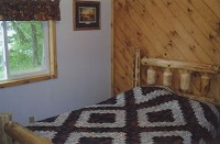 2 Twin Beds in Cabin #3 at Balsam Beach Resort on Lake Plantagenet.