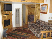 TV and seating area of cabin #5: Bear Cave.